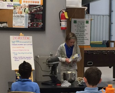 Giving a cooking demonstration