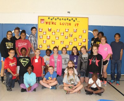 Students in front of their encouragement board