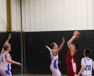 Boy's basketball - blocking the shot