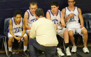 Boy's basketball - coach giving advice