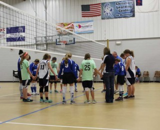 Praying before the volleyball match