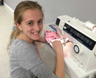 Working on her 4H sewing project