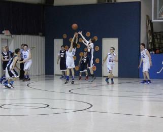 boys grabbing for the ball