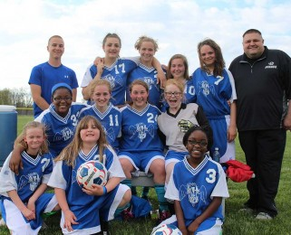 girls soccer team before their first game